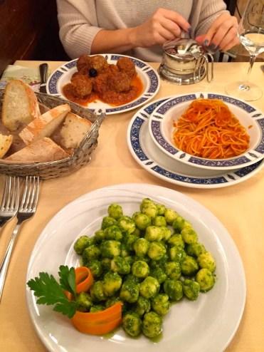 Meatballs with marinara and pasta; gnocchi with pesto.