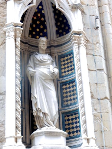 Pin-headed Gothic sculpture giving contrast to Donatello's sculpture