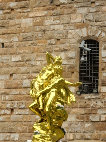 """""""Pluto and Proserpina"""" by Jeff Koons recently installed in the Piazza--an 11 foot, gold-colored steel monstrosity that might have been lovely on its own but next to all these ancient marble or copper statues just comes off as tacky at best. Apparently locals are not happy about this thing being here."""