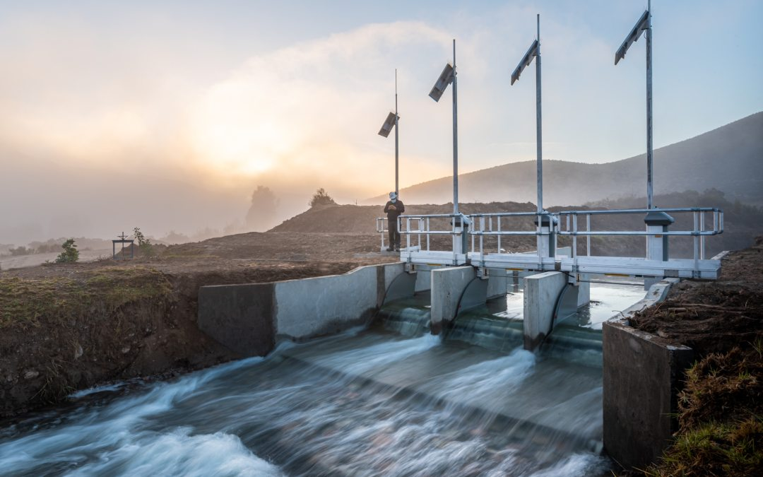 FlumeGate Regulating Structure Automating Flow for Bellavista in Chile with Sunrise over Agricultural region