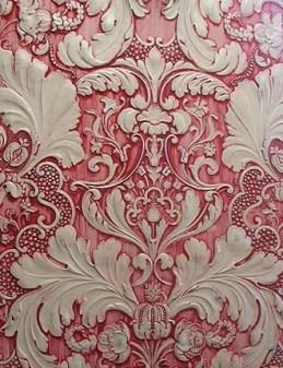 Pink embossed wallpaper.