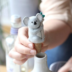 A cute little koala sits on a cork to keep all glass bottle drinks fresh! Perfect for animal lovers, this cute and quirky accessory fits into the top of wine or glass bottle drinks to seal them between use. Dimensions: width 5cm x height 8cm Made from: cork, resin Product Code: 42406 If you want to savour your favourite bottle of wine, one glass at a time, this fun and fancy bottle stopper will help keep it fresher for longer. Use the cork stopper to secure the koala in the spout of any white, red or rosé. Dimensions width 5cm x height 8cm Made from cork, resin