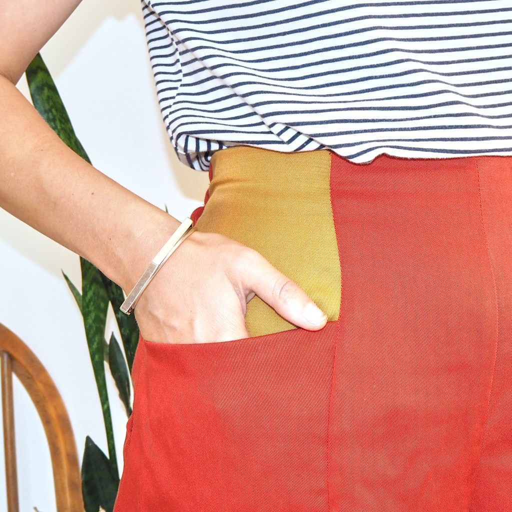 close up hand in pocket