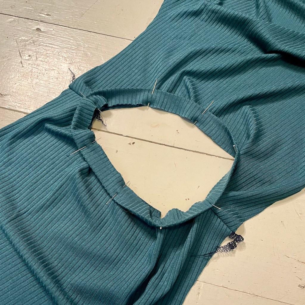 Pinning neckline of maternity dress