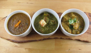 dal makhini, saag paneer, and coconut almond chicken curry