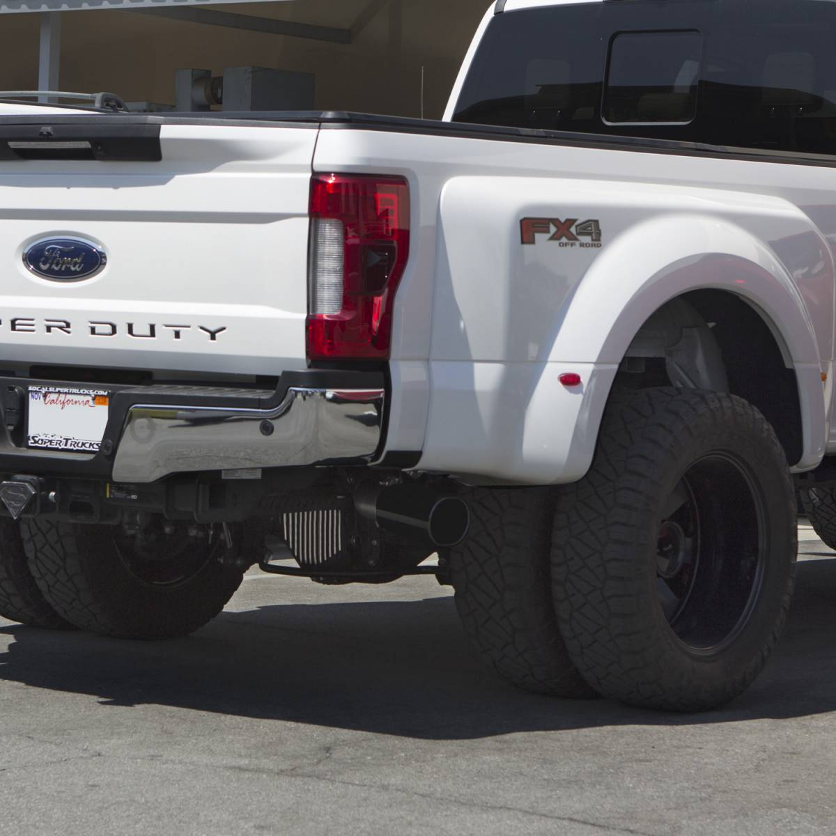 banks power monster exhaust system single exit black ob round tip 2017 2019 ford super duty 6 7l diesel