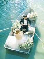 Idyllic Central Park Elopement with a Willowy Gown and Rowboat Portraits