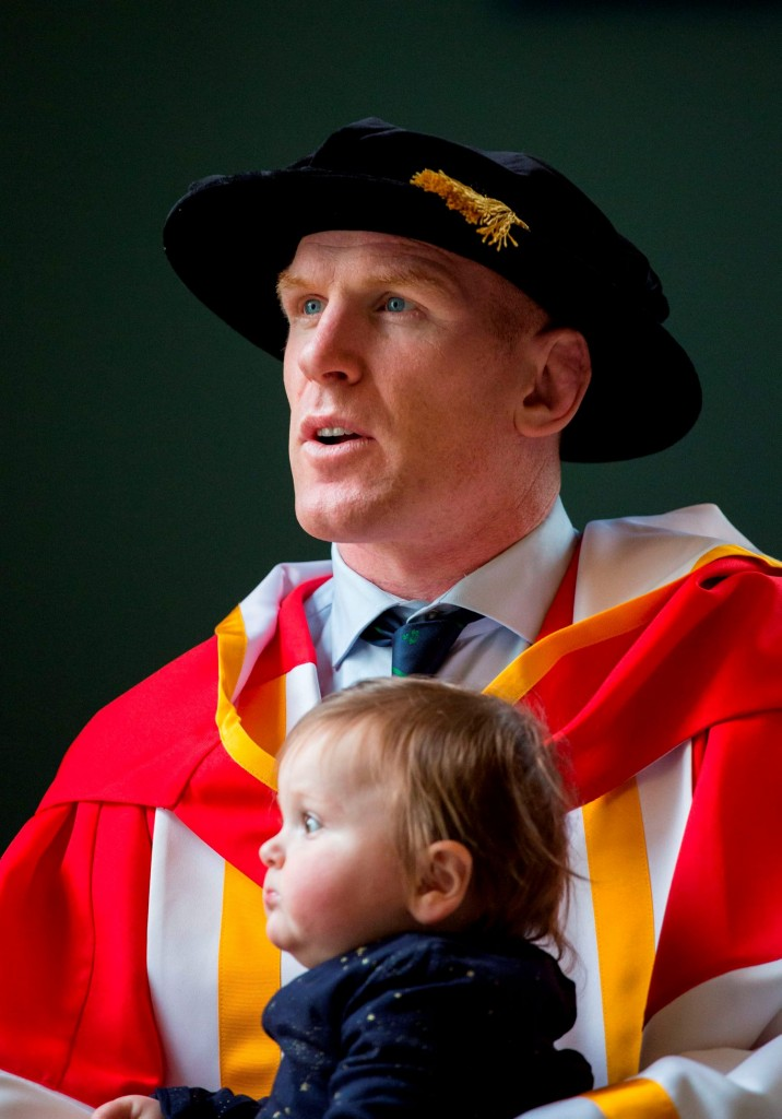 05/11/2015                 REPRO FREE The University of Limerick has awarded an Honorary Doctor of Science to former Ireland Rugby Captain Paul OÕConnell.  Dr Paul OÕConnell is the 100th recipient of an Honorary Doctorate from the University of Limerick since 1990. Dr Paul OÕConnell has a long association with the University of Limerick from his days training in the original PESS swimming pool as a secondary school student, to the years he spent studying computer engineering at UL.  He has been a director of the UL Foundation since 2011. In that role in 2012, he gave generously of his time to front the Paul OÕConnell Golf Outing, which raised in excess of Û50,000 to fund scholarships for students participating in ULÕs Access Programme. The scholarships enabled six students from socio-economically disadvantaged areas of Limerick to study degree programmes at the University.  Dr. Paul O'Connell is pictured with his daughter, Lola,1  as he prepared for the conferring ceremony. Picture: Alan Place/Fusionshooters.