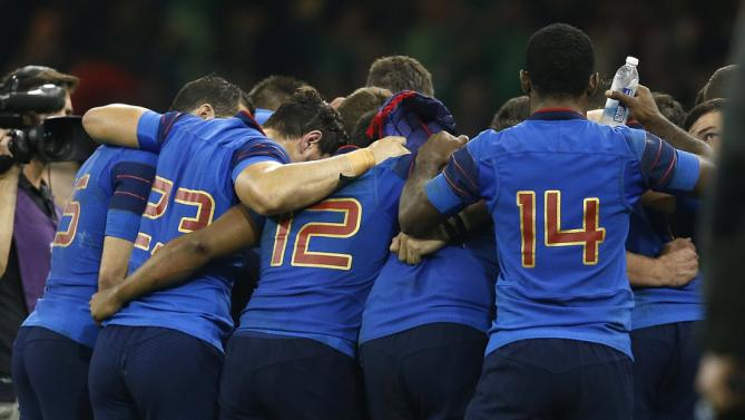 French players form a huddle after the Rugby World Cup Pool D match between France and Ireland at the Millennium Stadium in Cardiff, Wales, Sunday, Oct. 11, 2015. Ireland won the match 24-9. (AP Photo/Alastair Grant)