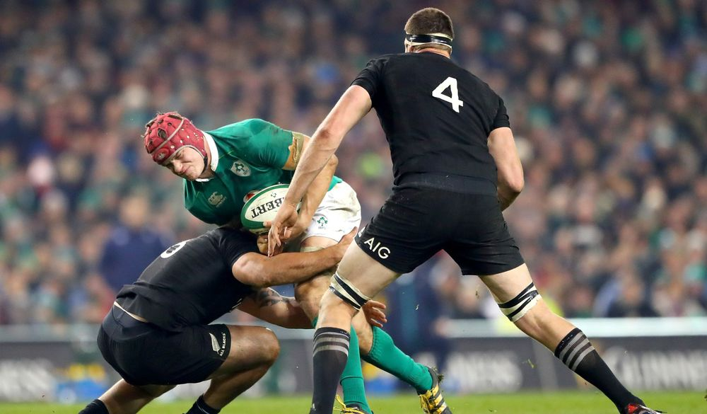 Guinness Series, Aviva Stadium, Dublin 19/11/2016 Ireland vs New Zealand New Zealand's Codie Taylor and Brodie Retallick tackle Josh van der Flier of Ireland Mandatory Credit ©INPHO/James Crombie