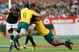 South Africa's Eben Etzebeth, center, is tackled by Australia's Dean Mumm, front, and teammate Scott Sio, right, during the Rugby Championship match between South Africa and Australia, at Loftus Versfeld in Pretoria, South Africa, Saturday, Oct. 1, 2016. (AP Photo/Themba Hadebe)