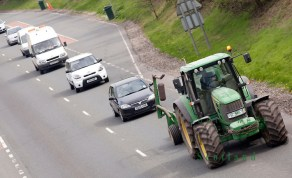 Queue of traffic behind tractor on the A75 road UK