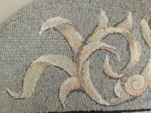 rug hooked fine cut shaded scroll closeup