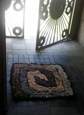 Brown and gray square spiral in the doorway, without the dog.