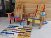 Biltmore stripes on the porch, with Adirondack chairs made from water skis.