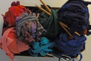 A second basket of fiber, with tools.