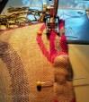 Machine hemming the long edge of a Pashmina shawl cut in half.