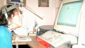 Rosemary Musachio using a head-pointer, which is simply a pointing stick mounted on a head strap that she uses to interact with a keyboard or a touchscreen.