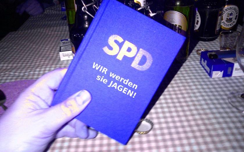 SPD-Parteibuch mit Wir werden sie jagen