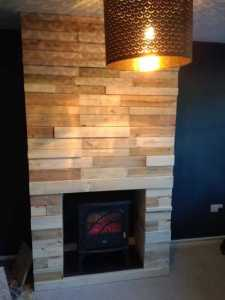 Throwing light on a Pallet fireplace with electric fire  storage