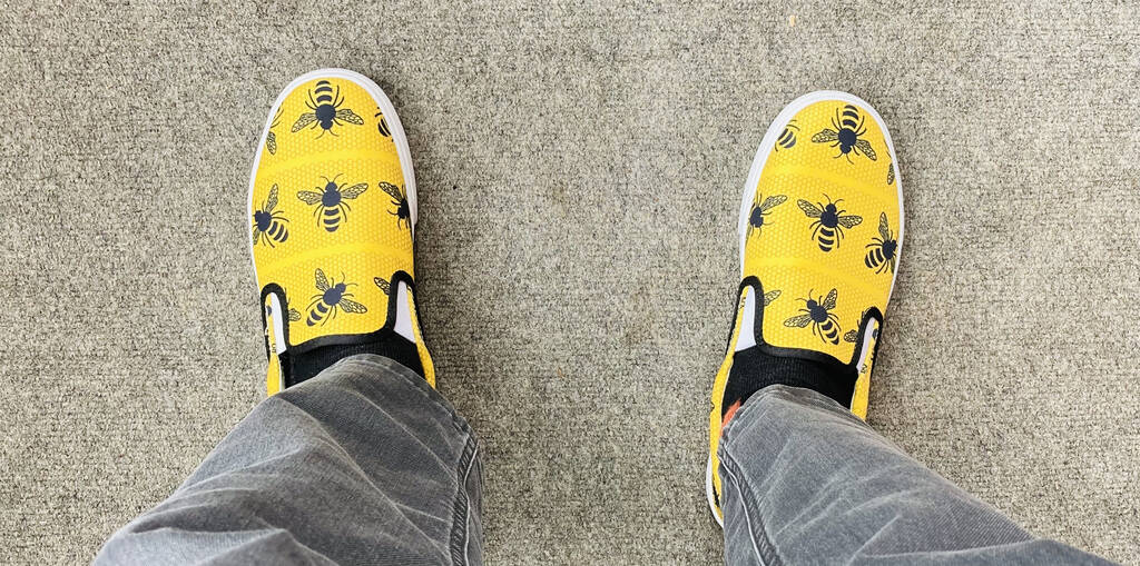My new yellow shoes, against a grey carpet background.