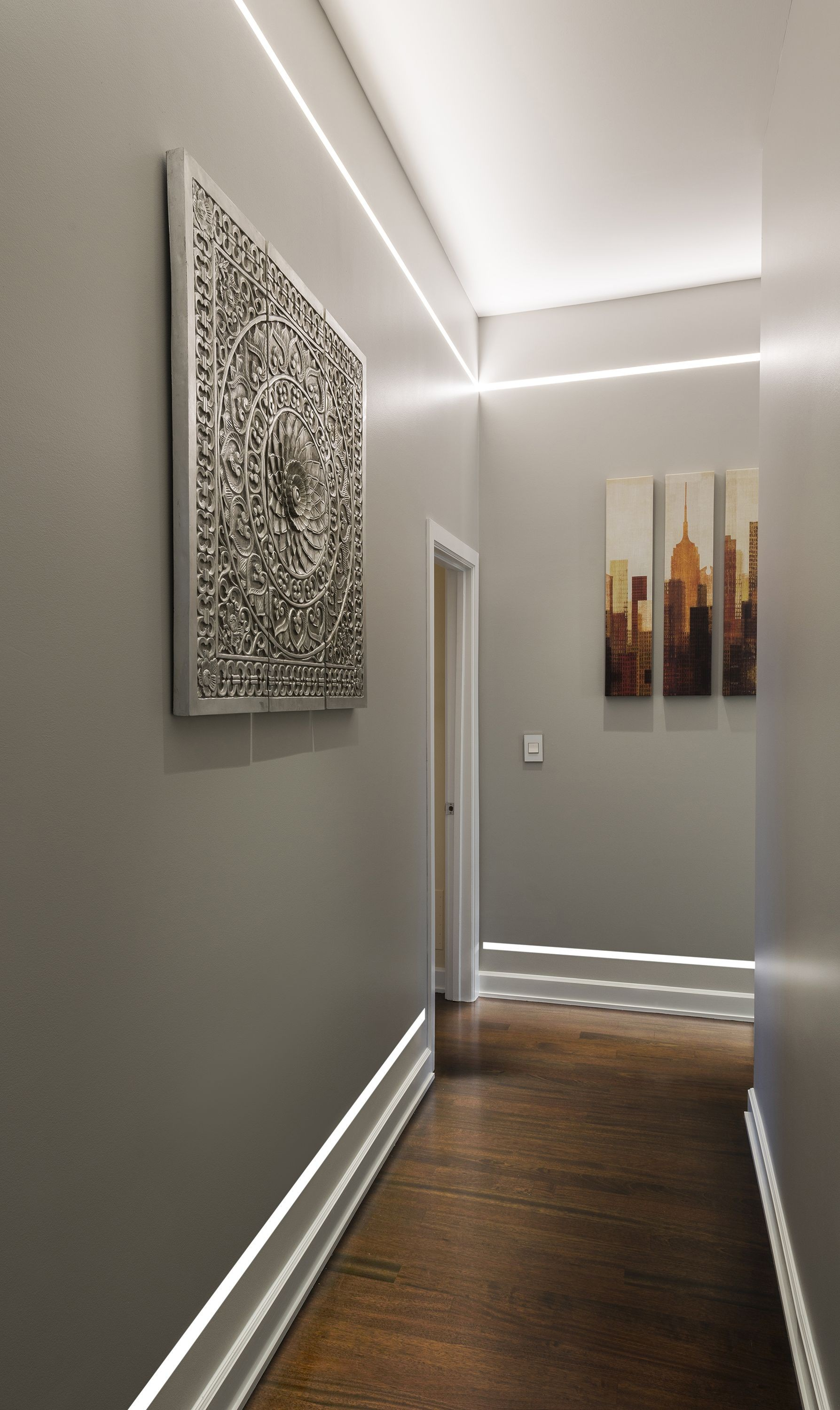 Illuminate a hallway without ceiling fixtures or wall sconces using Reveal plaster in LED system by Pure Lighting