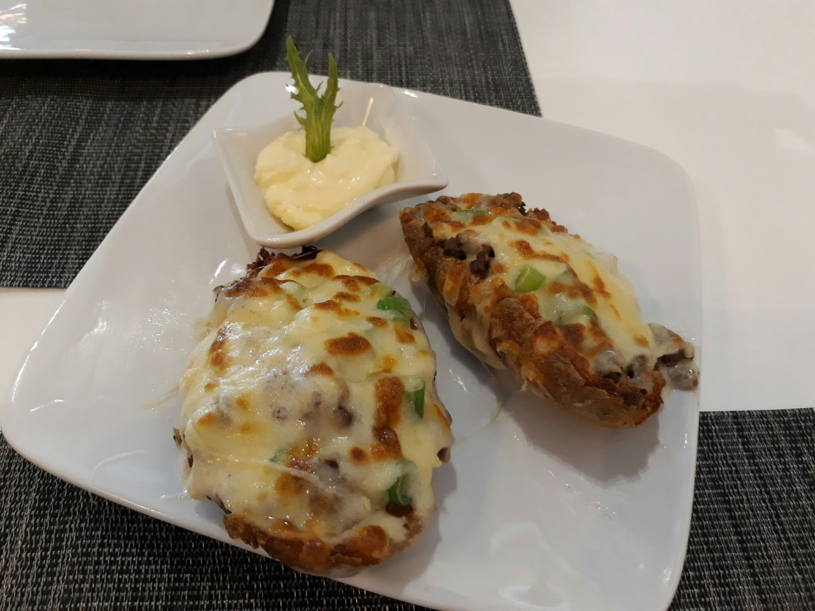 We had the Potato Skins as our starter Fully loaded with minced beef and cheese it was more filling than skin not that we minded
