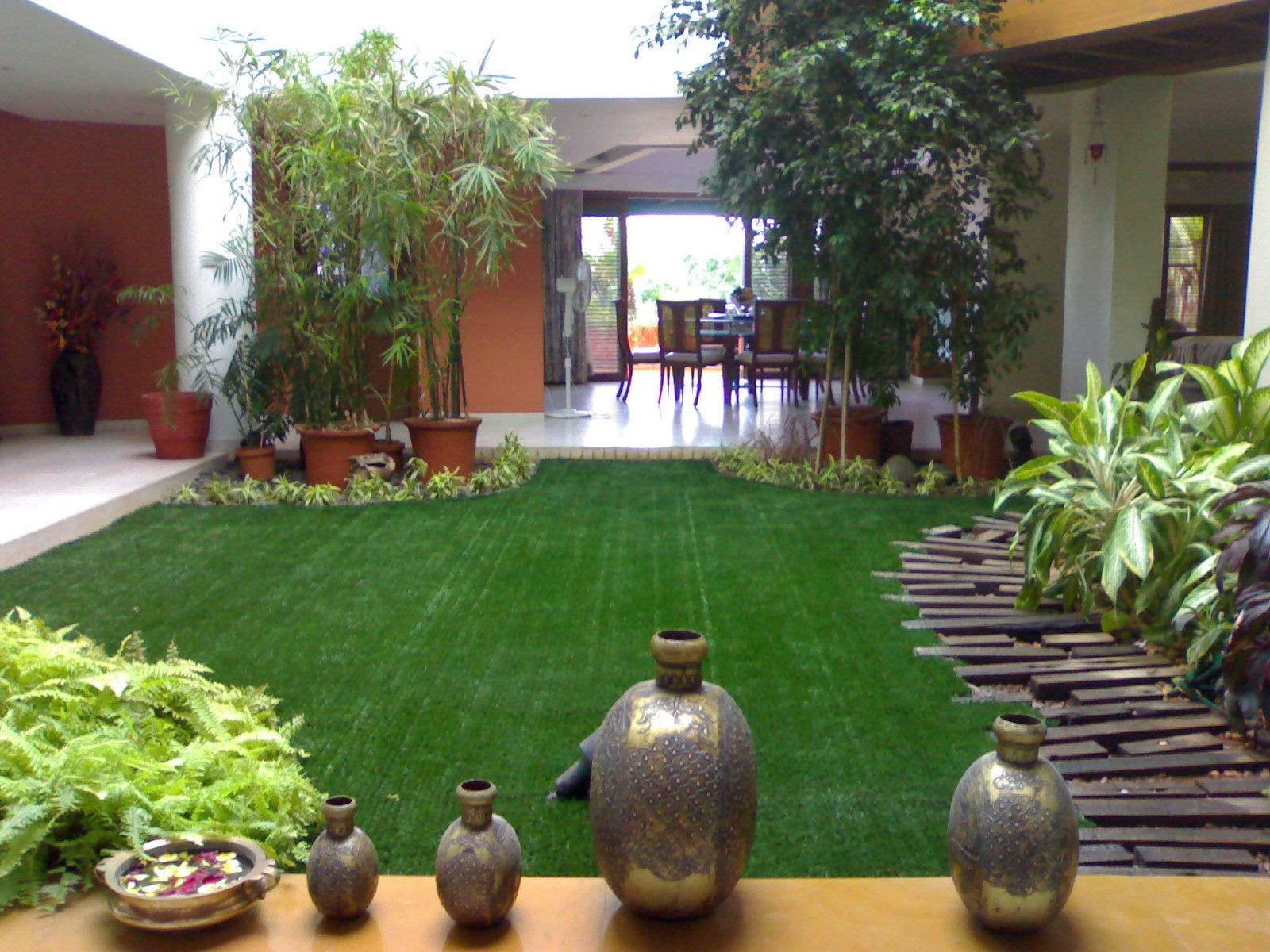 A beautiful garden adorned by our artificial grass inside a house in Hyderabad India