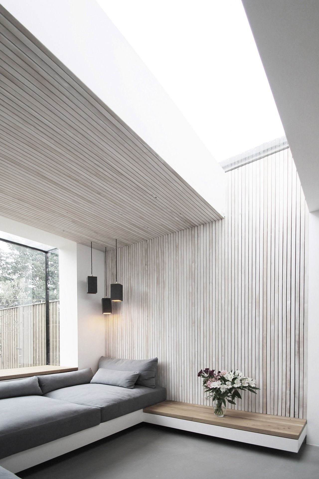 Scandinavian modern interior outdoors upknorth Ultra minimal white washed timber slat walls and ceiling Design by Studio 1 Architects
