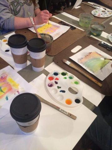 Students painting using watercolors
