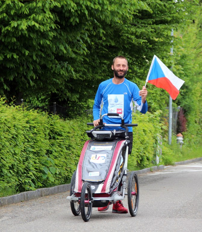 David running with CZ flag during Prague to Africa 2013