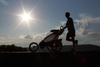 David running with baby stroller