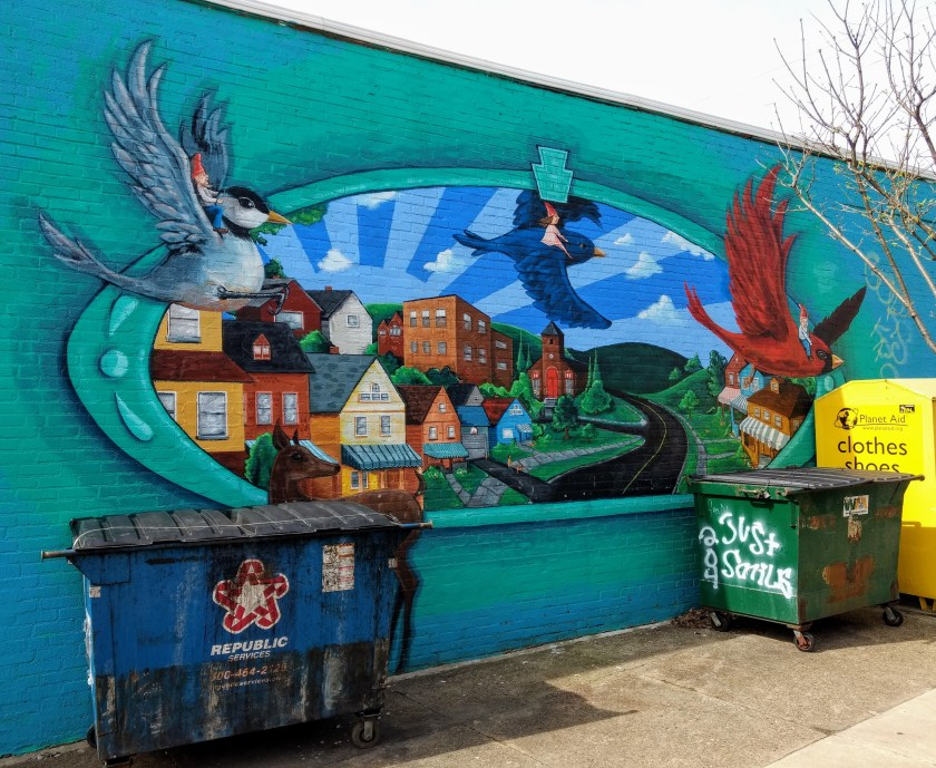 Mural in Morningside featuring large birds flying over the picturesque neighborhood