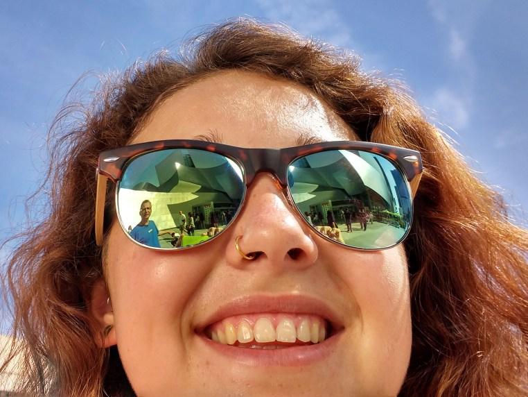 Disney Hall reflected in Zeinab Greif's sunglasses.