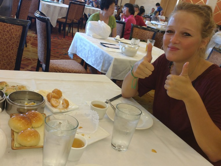 Stefanie Kuisle seated at a table in a dim sum restaurant
