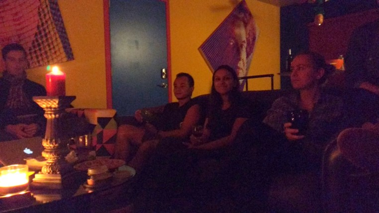 4 people sitting on couches