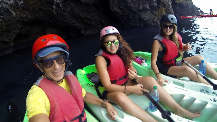 3 kayakers inside a sea cave