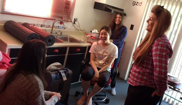 Johanna Acero blow drying Soojeen Heo's hair as Celeste Canete & Daleen Booyse