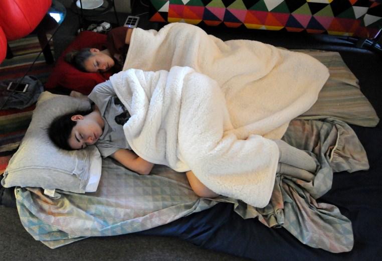 two people sleeping on the floor