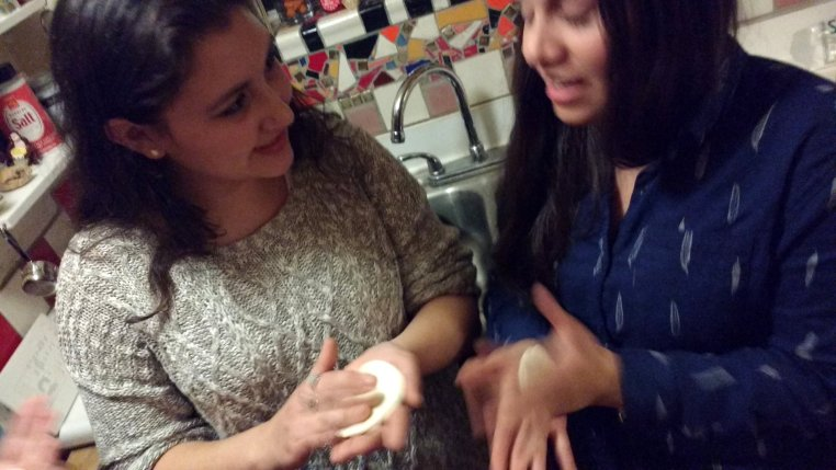 Celeste & Johanna sharing a story as they prepare dough