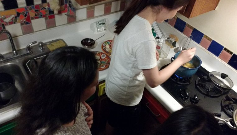 Soojeen frying the donuts!