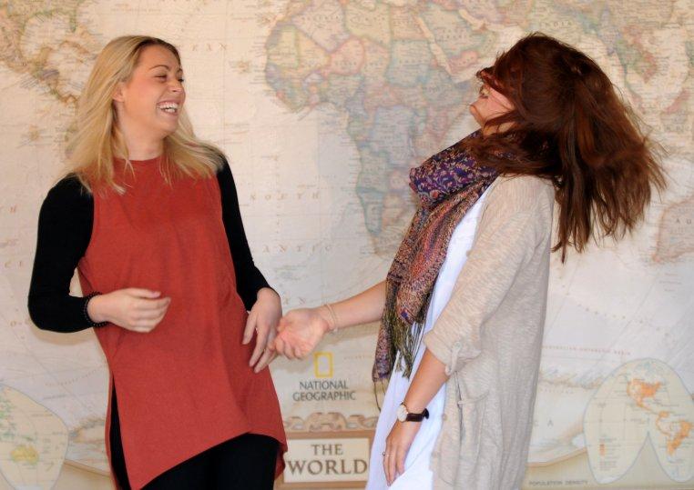 Kim Binnig & Nadine Schliedermann shake hands with hair flying