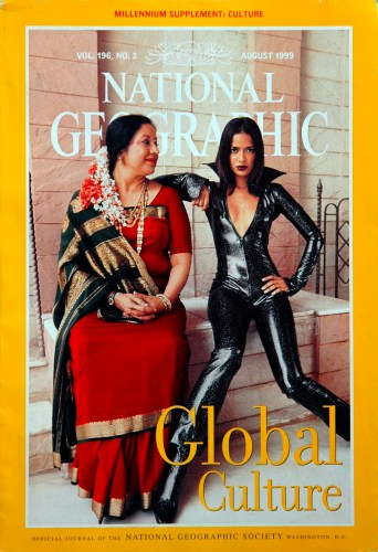 """Cover of National Geographic magazine, August 1999, showing a mother and daughter dressed in """"traditional"""" wear for their generations."""