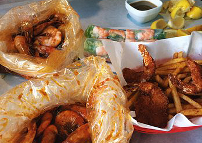 seafood in bags and an order of cajun fries