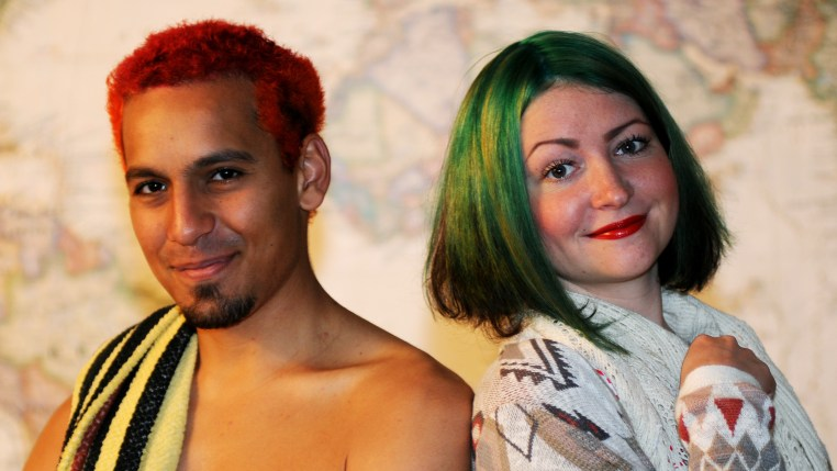 Samuel & Yulia with their finished hair: Samuel in orange and red, Yulia in green
