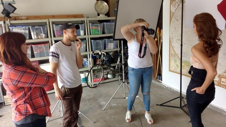 Photographer Tamara Williams, model Carmen Lee Solomons, makeup artist Sara Robey & hair stylist Eddie Cook work on a beauty photo shoot