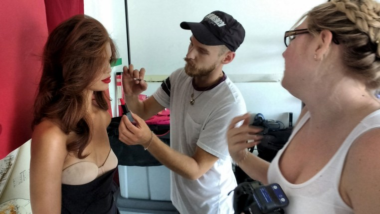 hair stylist Eddie Cook posing as makup artist for a photo of South African model Carmen Lee Solomons