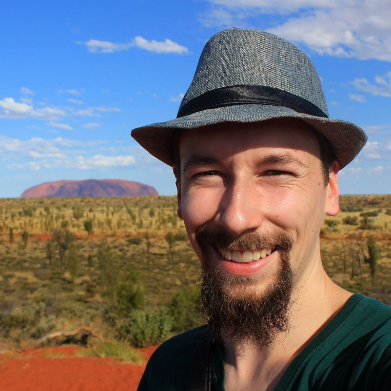 Arimo Kerkela in front of Ayers Rock, Australia