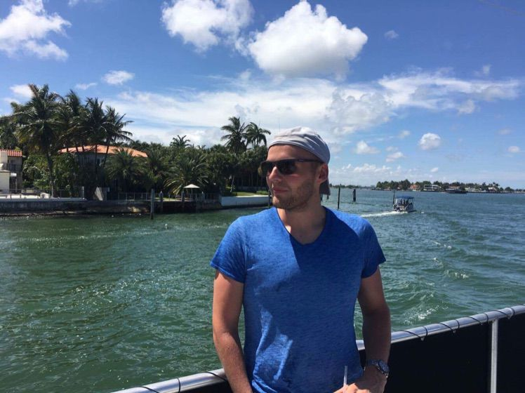 Piotr  Krasniewski standing by the water