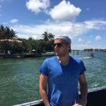 Piotr |Krasniewski standing by the water